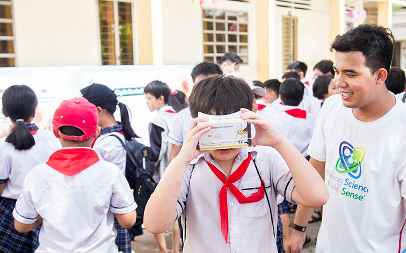 Advocacy, raising public awareness and community engagement are critical when it comes to source reduction in dengue control efforts. Quang Nguyen Thanh (Market Development Executive, Environmental Science Vietnam, Crop Science Division, Bayer) shows a primary school student at the Bayer Science Festival in Long An, Vietnam how to use Bayer Mosquito Quest – a virtual reality tool where users identify potential mosquito breeding spots in a typical home.